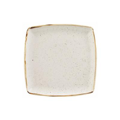Assiette carrée en ivoire...